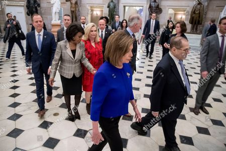 Jerrold Nadler, Adam Schiff, Maxine Waters, Carolyn Maloney, Richard Neil, Nancy Pelosi. House Speaker Nancy Pelosi of Calif., with from left, Chairman of the House Intelligence Committee Adam Schiff, D-Calif, Chairwoman of the House Financial Services Committee Maxine Waters, D-Calif., Chairwoman of the House Oversight and Reform Committee Carolyn Maloney, D-N.Y., Pelosi, Chairman of the House Ways and Means Committee Richard Neal, D-Mass., and Chairman of the House Judiciary Committee Jerrold Nadler, D-N.Y., walk to a news conference to unveil articles of impeachment against President Donald Trump, abuse of power and obstruction of Congress, on Capitol Hill in Washington