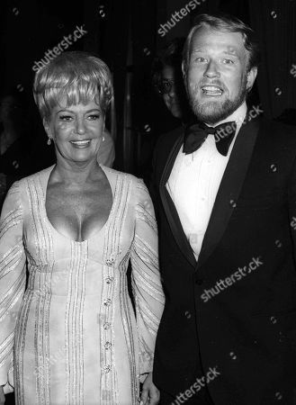 Stock Picture of A Black and White Photo of Betty Grable and Bob Remick Mouth Open Together at the Oscars at the Beverly Hilton Hotel On 04-10-1972