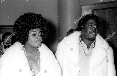 A Black and White Photo of Barry White Smiling Standing Next to His Wife Glodean with an Afro On 1/18/75