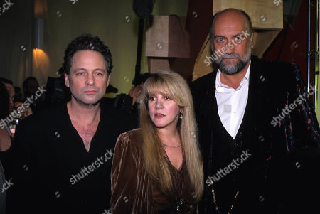 Lindsay Buckingham Mick Fleetwood and Stevie Nicks at the Rolling Stone Magazine 30 Year Covers Exhibit at Puck Bldg in NYC 1998 USA New York