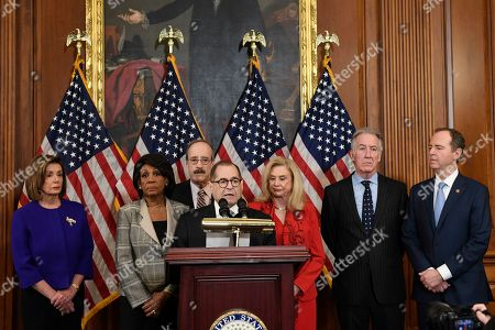 From left House Speaker Nancy Pelosi, Chairwoman of the House Financial Services Committee Maxine Waters, D-Calif., Chairman of the House Foreign Affairs Committee Eliot Engel, D-N.Y., House Judiciary Committee Chairman Jerrold Nadler, D-N.Y., Chairwoman of the House Committee on Oversight and Reform Carolyn Maloney, D-N.Y., House Ways and Means Chairman Richard Neal and Chairman of the House Permanent Select Committee on Intelligence Adam Schiff, D-Calif., unveil articles of impeachment against President Donald Trump, during a news conference on Capitol Hill in Washington