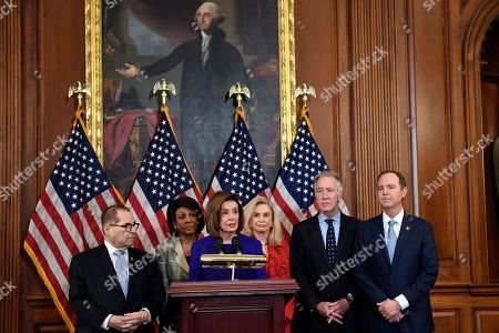 Jerrold Nadler, Maxine Waters, Nancy Pelosi, Carolyn Maloney, Richard Neal, Adam Schiff. House Speaker Nancy Pelosi of Calif., third from left, standing with, from left, House Judiciary Committee Chairman Jerrold Nadler, D-N.Y., House Financial Services Committee Chairwoman Maxine Waters, D-Calif., House Committee on Oversight and Reform Chair Carolyn Maloney, D-N.Y., House Ways and Means Committee Chairman Richard Neal, D-Mass., and House Intelligence Committee Chairman Adam Schiff, D-Calif., unveils two articles of impeachment against President Donald Trump, abuse of power and obstruction of Congress, during an event on Capitol Hill in Washington