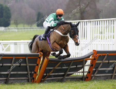 Stock Photo of Bullionaire and Jonathan Burke win the Paul James Knitwear Maiden Hurdle at Uttoxeter.