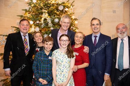 Stock Photo of Sarah Hope (right in red) and Victoria Panton- Bacon (twins and daughters of Elizabeth Hope) with Allegra Hinton (11) and Rollo Bacon (12) with Jeremy Vine (back centre) Paddy O'connell (far left) Lord Livsane (right) and author Ian Whybrow attending the charity annual Church service.