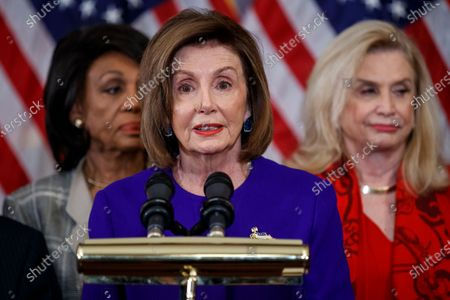 Speaker of the House Nancy Pelosi, with House Oversight and Reform Committee Chairwoman Carolyn Maloney (R) and House Financial Services Committee Chairwoman Maxine Waters (L), delivers remarks during a press conference to unveil two articles of impeachment, charging President Donald Trump with abuse of power and obstruction of Congress, on Capitol Hill in Washington, DC, USA, 10 December 2019. The Judiciary Committee will vote on the two articles Thursday, setting up a vote on the House floor next week.
