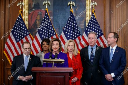 Speaker of the House Nancy Pelosi (3-L), with House Judiciary Committee Chairman Jerrold Nadler (L), House Permanent Select Committee on Intelligence Chairman Adam Schiff (R), House Ways and Means Committee Chairman Richard Neal (2-R),House Oversight and Reform Committee Chairwoman Carolyn Maloney (3-R), House Financial Services Committee Chairwoman Maxine Waters (2-L), delivers remarks during a press conference to unveil two articles of impeachment, charging President Donald Trump with abuse of power and obstruction of Congress, on Capitol Hill in Washington, DC, USA, 10 December 2019. The Judiciary Committee will vote on the two articles Thursday, setting up a vote on the House floor next week.