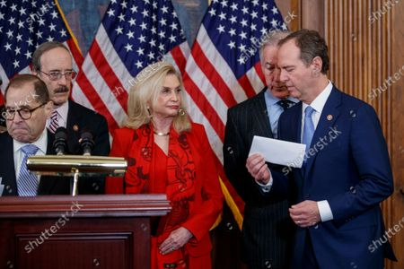 House Permanent Select Committee on Intelligence Chairman Adam Schiff (R), with House Judiciary Committee Chairman Jerrold Nadler (L), House Foreign Affairs Committee Chairman Eliot Engel (2-L), House Oversight and Reform Committee Chairwoman Carolyn Maloney (C) House Ways and Means Committee Chairman Richard Neal (2-R), prepares to deliver remarks during a press conference to unveil two articles of impeachment, charging President Donald Trump with abuse of power and obstruction of Congress, on Capitol Hill in Washington, DC, USA, 10 December 2019. The Judiciary Committee will vote on the two articles Thursday, setting up a vote on the House floor next week.