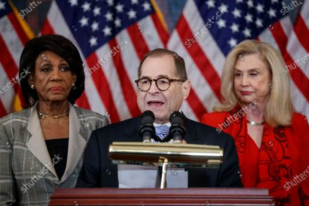 House Judiciary Committee Chairman Jerrold Nadler, with House Oversight and Reform Committee Chairwoman Carolyn Maloney (R) and House Financial Services Committee Chairwoman Maxine Waters (L), delivers remarks during a press conference to unveil two articles of impeachment, charging President Donald Trump with abuse of power and obstruction of Congress, on Capitol Hill in Washington, DC, USA, 10 December 2019. The Judiciary Committee will vote on the two articles Thursday, setting up a vote on the House floor next week.