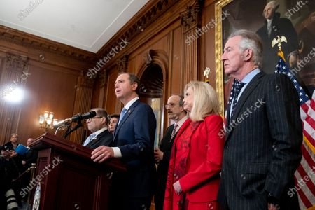 House Permanent Select Committee on Intelligence Chairman Adam Schiff (L) speaks beside Speaker of the House Nancy Pelosi (Back L), House Foreign Affairs Committee Chairman Eliot Engel (3-R), House Oversight and Reform Committee Chairwoman Carolyn Maloney (2-R) and Chairman of the House Ways and Means Committee Richard Neal (R) during the unveiling of two articles of impeachment, charging US President Donald Trump with abuse of power and obstruction of Congress, during a press conference on Capitol Hill in Washington, DC, USA, 10 December 2019. The Judiciary Committee will vote on the two articles Thursday, setting up a vote on the House floor next week.