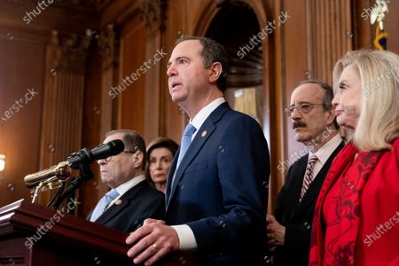 House Permanent Select Committee on Intelligence Chairman Adam Schiff (C) speaks beside Speaker of the House Nancy Pelosi (Back L), House Foreign Affairs Committee Chairman Eliot Engel (2-R) and House Oversight and Reform Committee Chairwoman Carolyn Maloney (R) during the unveiling of two articles of impeachment, charging US President Donald Trump with abuse of power and obstruction of Congress, during a press conference on Capitol Hill in Washington, DC, USA, 10 December 2019. The Judiciary Committee will vote on the two articles Thursday, setting up a vote on the House floor next week.