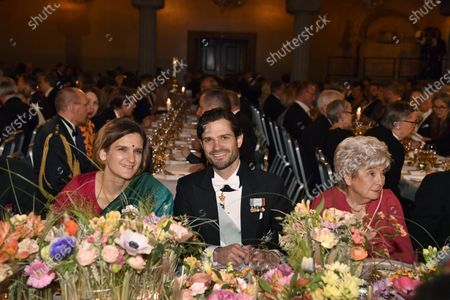 Nobel Prize for Economics laureate, French Esther Duflo (L), Swedish Prince Carl Philip (C) and Jean Alison Peebles at the Nobel banquet at the City Hall in Stockholm, Sweden, 10 December 2019.