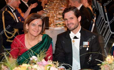 Economics laureate Esther Duflo and Prince Carl Philip attend the Nobel banquet at the City Hall in Stockholm, Sweden, 10 December 2019.