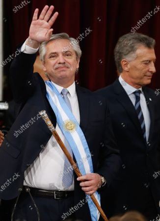 Argentinian President Alberto Fernandez receives the baton from his predecessor Mauricio Macri (R), during the investiture ceremony at the Congress facilities in Buenos Aires, Argentina, 10 December 2019.