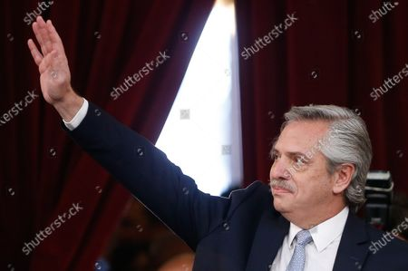 Argentinian President Alberto Fernandez waves upon receiving the baton from his predecessor Mauricio Macri, during the investiture ceremony at the Congress facilities in Buenos Aires, Argentina, 10 December 2019.