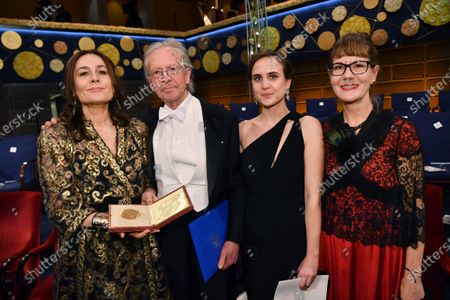Stock Picture of Literature laureate Peter Handke, his wife Sophie Semin Handke (L) and daughters (R) pose with his Nobel medal at the Nobel Prize award ceremony.