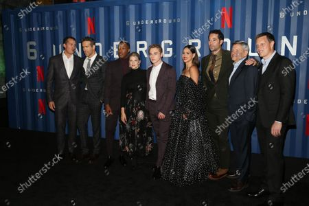 Stock Photo of Scott Stuber, Ryan Reynolds, Corey Hawkins, Melanie Laurant, Ben Hardy, Adria Arjona, Manuel Garcia-Rulfo, Ted Sarandos and David Ellison