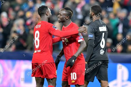 Liverpool's Naby Keita, left, celebrates after scoring his side's opening goal with Liverpool's Sadio Mane during the group E Champions League soccer match between Salzburg and Liverpool, in Salzburg, Austria