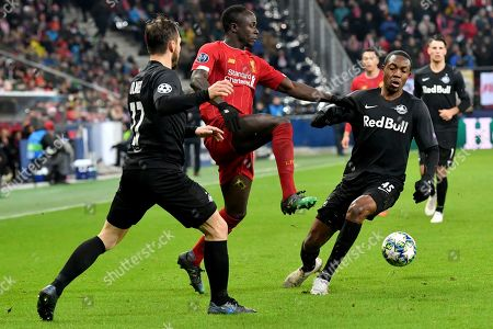 Stock Picture of Liverpool's Sadio Mane, center, is challenged by Salzburg's Enock Mwepu, right, during the group E Champions League soccer match between Salzburg and Liverpool, in Salzburg, Austria