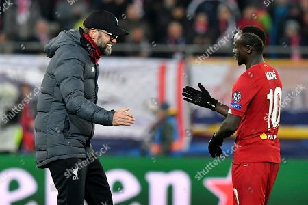 Liverpool's manager Jurgen Klopp celebrates with Liverpool's Sadio Mane at the end of the group E Champions League soccer match between Salzburg and Liverpool, in Salzburg, Austria