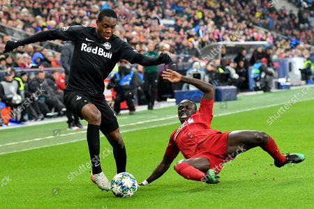 Salzburg's Enock Mwepu, lft, fights for the ball with Liverpool's Sadio Mane during the group E Champions League soccer match between Salzburg and Liverpool, in Salzburg, Austria