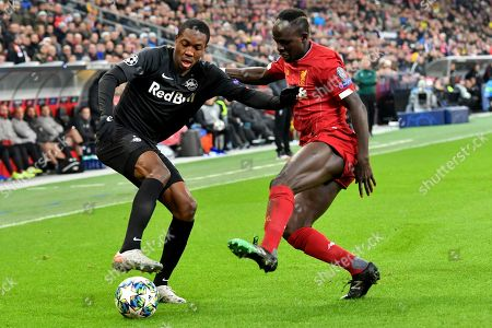 Stock Photo of Salzburg's Enock Mwepu, left, fights for the ball with Liverpool's Sadio Mane during the group E Champions League soccer match between Salzburg and Liverpool, in Salzburg, Austria