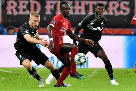 Stock Image of Liverpool's Sadio Mane, center, fights for the ball with Salzburg's Erling Braut Haland, left and Salzburg's Enock Mwepu during the group E Champions League soccer match between Salzburg and Liverpool, in Salzburg, Austria