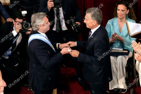 The new President of Argentina, Alberto Fernandez (L), receives the baton from the outgoing President, Mauricio Macri (R), during the inauguration in Buenos Aires, Argentina, 10 December 2019.