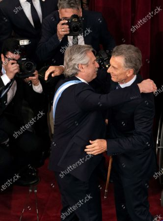 The new President of Argentina, Alberto Fernandez (L), hugs the outgoing President, Mauricio Macri (R), during the inauguration in Buenos Aires, Argentina, 10 December 2019.