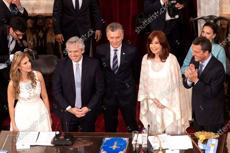 (L-R) Claudia Ledesma Abdala de Zamora, elected senator and future provisional president of the Senate; the new president of Argentina, Alberto Fernandez; outgoing president Mauricio Macri; the new Argentine vice president Cristina Fernandez, and the Argentine politician Sergio Massa, who will preside over the Chamber of Deputies, smile during the presidential inauguration ceremony in Buenos Aires, Argentina, 10 December 2019.
