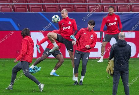 Stock Picture of FC Lokomotiv Moscow's players Vedran Corluka (3-L) and Benedikt Howedes (2-L) attend a training session at Wanda Metropolitano stadium, in Madrid, Spain, 10 December 2019. FC Lokomotiv Moscow will face Atletico Madrid in their UEFA Champions League group stage soccer match on 11 December 2019.