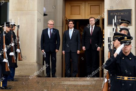 Peter Hultqvist, Antti Kaikkonen, Mark Esper. Defense Secretary Mark Esper, center, flanked by Swedish Defense Minister, Peter Hultqvist, left, and Finnish Defense Minister Antti Kaikkonen, right, stand together during the playing of a national anthem during an Enhanced Honor Cordon ceremony at the Pentagon in Washington