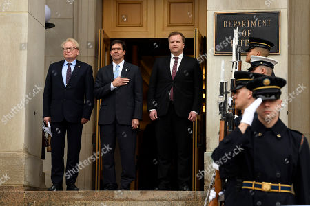 Peter Hultqvist, Antti Kaikkonen, Mark Esper. Defense Secretary Mark Esper, center, flanked by Swedish Defense Minister, Peter Hultqvist, left, and Finnish Defense Minister Antti Kaikkonen, right, stand together during the playing of the National Anthem during an Enhanced Honor Cordon ceremony at the Pentagon in Washington
