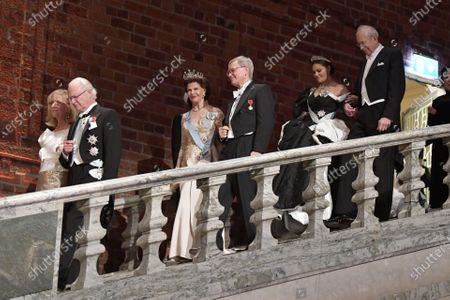 King Carl Gustaf and Professor Evi Heldin, Queen Silvia and Carl-Henrik Heldin, Crown Princess Victoria and James Peebles during the Nobel award ceremony.