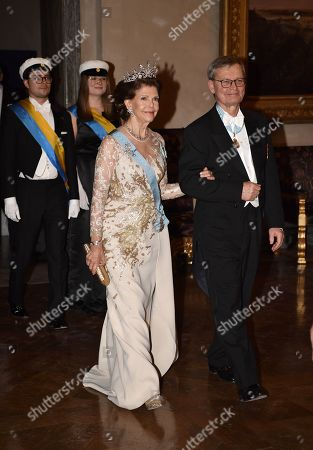 Stock Image of Queen Silvia and Carl-Henrik Heldin, Chairman of the Nobel Foundation, during the Nobel award ceremony.
