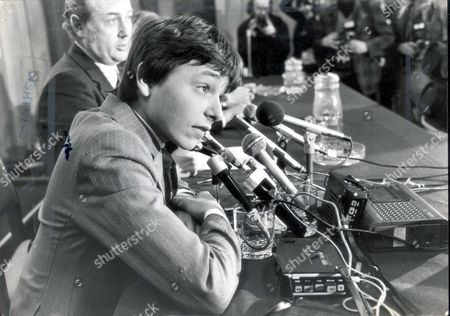 Stock Image of Jockey Steve Cauthen 1979 Facing The Microphones And Tricky Questions From The Press Is Steve Cauthen. On Saturday The Real Business Of Riding Horses On British Courses Begins. Steve Cauthen Rider Of 944 Winners Of Races Worth $12 Million In The United States Since May 1976 Came Through His First British Ordeal In Lester Piggott-style Yesterday. The Kid Was Ice-cool As He Faced A Media Army In London. Yes He Had Met Mr Piggott Who Didn't Say Too Much ' And No He Would Not Be Taking Willie Carson's Advice Which Was: 'follow Me But Not Too Close.' Cauthen Is Here To Ride For Leading Owner Robert Sangster (died April 2004) And He Will Not Be Short Of The Best Advice As He Tries To Make His Name Here. He Will Live At Lambourn Near Trainer Barry Hills And Jimmy Lindley Who Has Been Appointed His Manager And Adviser. And Last Night Eddie Arcaro Beloved 'banana Nose' Of American Racing Flew Here To Cover For American Tv The British Debut Of The Kid At Salisbury On Saturday. ...jockeys