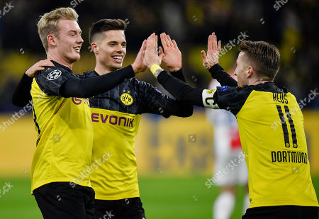 Dortmund's Marco Reus, Dortmund's Julian Weigl and Dortmund's Julian Brandt, from right, celebrate their opening goal during the Champions League Group F soccer match between Borussia Dortmund and Slavia Praha in Dortmund, Germany