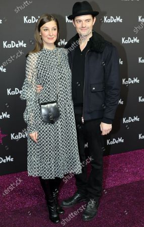 German-Romanian actress Alexandra Maria Lara (L) and her husband and actor Sam Riley (R) attend the grand opening of the Kaufhaus des Westens (KaDeWe) department store in Berlin, Germany, 10 December 2019. The KaDeWe is the second largest department store in Europe with over 60 thousand square meters of selling space. At the moment the building is undergoing a major refurbishment process.