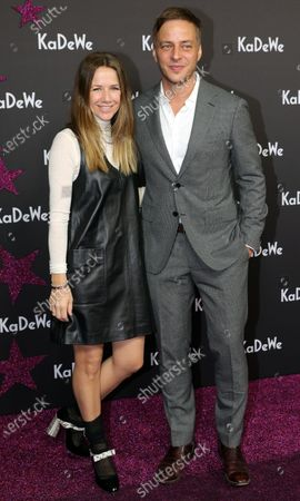 German actress Alexandra Neldel (L) and German actor Tom Wlaschiha (R) attend the grand opening of the Kaufhaus des Westens (KaDeWe) department store in Berlin, Germany, 10 December 2019. The KaDeWe is the second largest department store in Europe with over 60 thousand square meters of selling space. At the moment the building is undergoing a major refurbishment process.