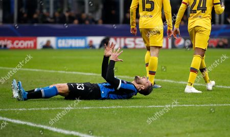 Inter Milan's Danilo D'Ambrosio, left, reacts after missing a chance to score during the Champions League group F soccer match between Inter Milan and Barcelona at the San Siro stadium in Milan, Italy