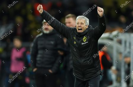 Dortmund's head coach Lucien Favre celebrates Dortmund's Julian Brandt's goal during the UEFA Champions League group F soccer match between Borussia Dortmund and Slavia Prague in Dortmund, Germany, 10 December 2019.