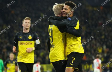 Dortmund's Julian Brandt (C) celebrates with teammate Jadon Sancho (R) after scoring during the UEFA Champions League group F soccer match between Borussia Dortmund and Slavia Prague in Dortmund, Germany, 10 December 2019.