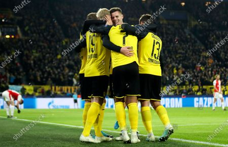 Dortmund's Julian Brandt (L) celebrates with teammates after scoring during the UEFA Champions League group F soccer match between Borussia Dortmund and Slavia Prague in Dortmund, Germany, 10 December 2019.
