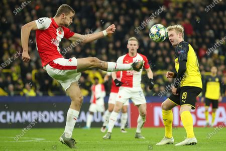 Slavia's Tomas Soucek (L) in action against Dortmund's Julian Brandt (R) during the UEFA Champions League group F soccer match between Borussia Dortmund and Slavia Prague in Dortmund, Germany, 10 December 2019.