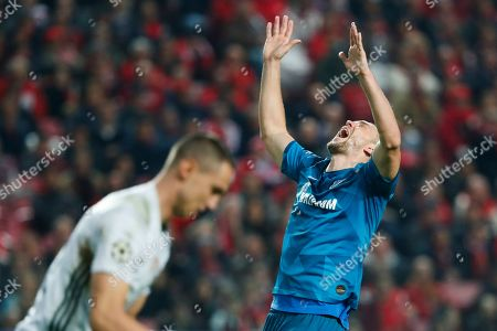 Stock Picture of Zenit's Artem Dzyuba gestures during the Champions League group G soccer match between Benfica and Zenit St. Petersburg at the Luz stadium in Lisbon, . Benfica won 3-0