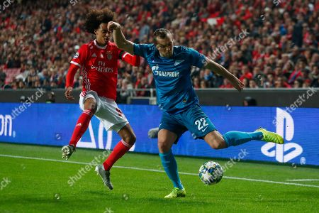 Zenit's Artem Dzyuba, right, vies for the ball with Benfica's Tomas Tavares during the Champions League group G soccer match between Benfica and Zenit St. Petersburg at the Luz stadium in Lisbon