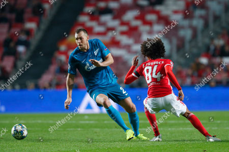 Zenit's Artem Dzyuba, left, sidesteps Benfica's Tomas Tavares during the Champions League group G soccer match between Benfica and Zenit St. Petersburg at the Luz stadium in Lisbon