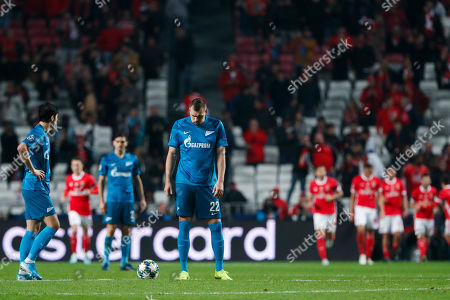 Zenit's Artem Dzyuba, right, stands next to the ball while Benfica players, foreground right, celebrate the opening goal during the Champions League group G soccer match between Benfica and Zenit St. Petersburg at the Luz stadium in Lisbon