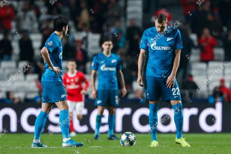 Zenit's Artem Dzyuba, right, stands next to the ball after Benfica's Franco Cervi scored the opening goal during the Champions League group G soccer match between Benfica and Zenit St. Petersburg at the Luz stadium in Lisbon
