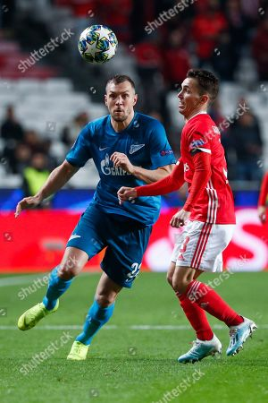 Zenit's Artem Dzyuba, left, battles for the ball with Benfica's Alex Grimaldo during the Champions League group G soccer match between Benfica and Zenit St. Petersburg at the Luz stadium in Lisbon