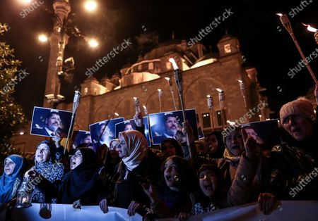Protestors hold pictures of the former Egyptian President Mohamed Morsi as they shout slogans against the Egyptian President Abdel Fattah al-Sisi during a protest for death penalty in Egypt, after the evening pray at Fatih Mosque in Istanbul, Turkey, 10 December 2019.